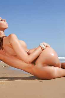 Hot Brunette with big breasts enjoy on the beach