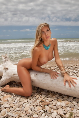 Caludia nude on tropical beach with perfect body