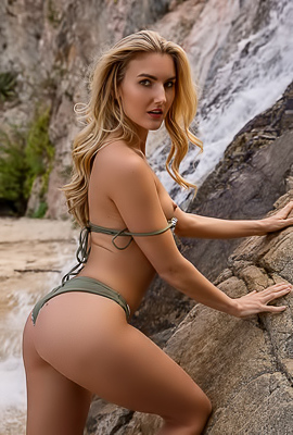 Anna Katarina showing her nude body by a waterfall