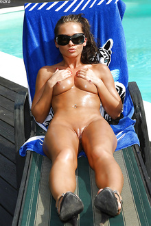 Sandra Rubs Down with Oil by the Pool