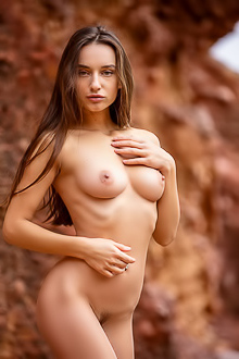 Gloria Sol explores the mountains in the nude